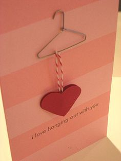 "DIY Valentine's Day Card ""I Love Hanging Out with You"" with a clothes hanger and a red heart."