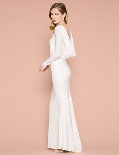 The exposed back of this bridal gown highlights your wedding hair. #lechateau #lewedding #styledowntheaisle