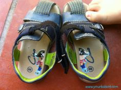 Putting on shoes: Left and Right.  A simple tip using a sticker cut in half stuck onto each shoe.  Great for toddlers and preschoolers.