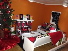 Finished living room in American Girl Doll house. All decorated for Christmas morning.