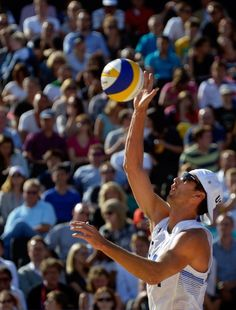 USA's Sean Rosenthal serves during the men's Beach Volleyball preliminary phase Pool D match against Latvia
