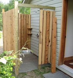 Outdoor Shower. I want it. Maybe not this rustic. or paint to match the house.