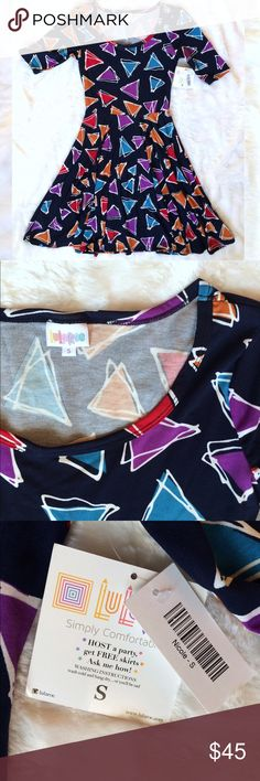LuLaRoe Nicole Dress Beautiful Nicole dress from LuLaRoe. Fun geometric triangle pattern on a navy blue background. Make me an offer. Discount on bundles of two or more. LuLaRoe Dresses Midi