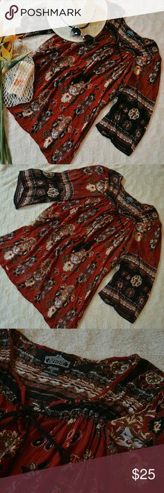 Angie Boho Tunic / Mini Dress Boho tunic in great used condition from Angie! Depending on height, could also be worn as a mini dress. Fabric features a beautiful, elaborate floral paisley pattern in a maroon and black color. Also features bell sleeves and decorative beading and tassles.  Measurements and fabric content available upon request. I welcome all reasonable offers! Bundle with another item in my closet to save 15% off your total purchase. Angie Tops Tunics