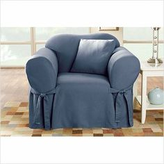 """Sure Fit Cotton Duck Armchair Slipcover - Linen by Sure Fit. $31.71. Updates your favorite armchair with durable fabric and a chic understated neutral. Care and Cleaning: Tumble Dry Low, Remove Promptly, Machine Wash. Decorative Accents: Scalloped Edge. Slipcover Fit Type: Loose. Slipcover Measurements: Non-Stretch Back Height: 32"""" - 44"""". Machine wash. Features: Elastic Band Under Seat Cushion,. Also available: Matching slipcovers for sofas and loveseats. 100% cotton duck. ..."""