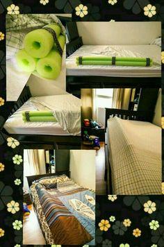 Pool noodles under sheets of floor bed