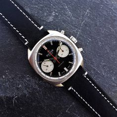 About this watch:  Fantastic Vintage Silgar Extra Reverse Panda Dial Mens Chronograph Watch, made in 1960s, also know as a Poormans Heuer Carrera 7753 NS  The watch uses a high quality manual mechanical winding Swiss Made Landeron 248 movement (also used in top quality Swiss Save The Pandas, Carrera, Chronograph, Omega Watch, 1960s, Manual, Watches, Trending Outfits, Unique Jewelry