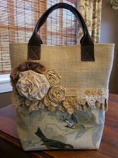 Beige Canvas and floral cotton tote with leather handles. Fabric flowers