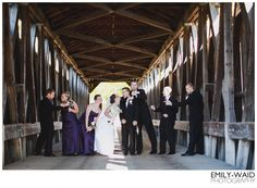 portraits under a covered bridge