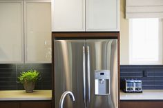 Stainless steel appliances break up the flow of traditional cabinetry.