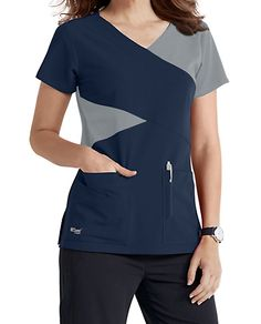 The Grey's Anatomy Signature mock wrap scrub top has detailed style lines and roomy pockets. Cute Scrubs Uniform, Spa Uniform, Scrubs Pattern, Stylish Scrubs, Greys Anatomy Scrubs, Medical Uniforms, Medical Scrubs, Workwear Fashion, Nursing Dress