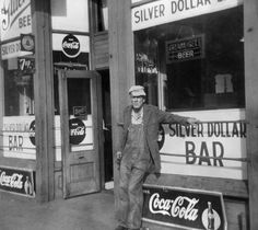 The Silver Dollar Bar and one of its habitues in 1950. In a previous time, Washington Avenue was all bars, pawnshops and flophouses.