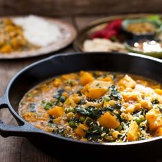 Chickpea and Butternut Squash Curry vy vikalinka: Chickpeas and butternut squash are so satisfying in this vegetarian curry you won't miss meat!  http://vikalinka.com/2013/09/26/chickpea-and-butternut-squash-curry/
