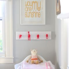 This neon pink hook rack is made from toy animals - and is too cute!