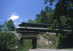 Southern Railway passenger train on concrete bridge near Andrews Geyser in North Carolina