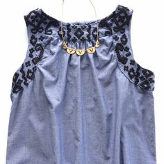 Listing! Aztec embroidered blue cotton tank Stunning summer top just waiting to be added to your warm weather collection! Looser boho fitting top in great condition. Minor wash wear. Bust 19 1/2 inches. Length 24 inches. Old Navy Tops Tank Tops