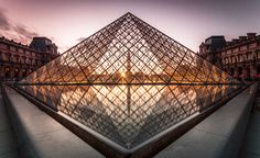 paris france - september the louvre pyramid at dusk on september 28 2012 in paris. it serves as the main entrance to the louvre museum. completed in 1989 and is a landmark of the city of paris. Louvre Pyramid, Architecture Images, 11th Century, Main Entrance, Malaga, Paris France, Night Life, Royalty Free Stock Photos, Museum