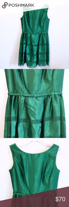 Taylor Green Dress with Flat Bow Belt and Stripes This dress is such a beautiful, rich green color in a satiny material. There's a thin bow belt at the waist and subtle stripes on the skirt in a mesh material. The back has a v-neck with buttons and a zipper underneath. This dress is a structured shape and would be so flattering on! In great condition! Taylor Dresses Mini