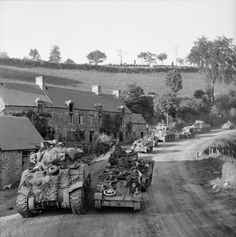 Sherman tanks and Bren carriers on the road to Montchamp during the advance towards Vassy, 4 August 1944.