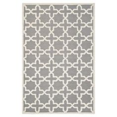 Stylishly anchor your living room or master suite with this lovely wool rug, showcasing an elegant trellis motif in silver and ivory.  via Joss and Main