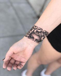 25 Medusa Tattoo Design Ideas with Meaning - medusa wrist band tattoo - Armband Tattoo, Wrist Band Tattoo, Tattoo Bracelet, Wrist Tattoos, Sleeve Tattoos, Shoulder Tattoos, Arrow Tattoos, Arm Cuff Tattoo, Torso Tattoos