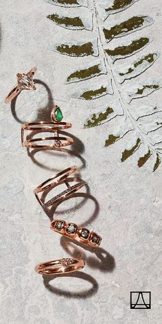 Rose gold stacking rings with diamonds and emeralds. One is never enough.