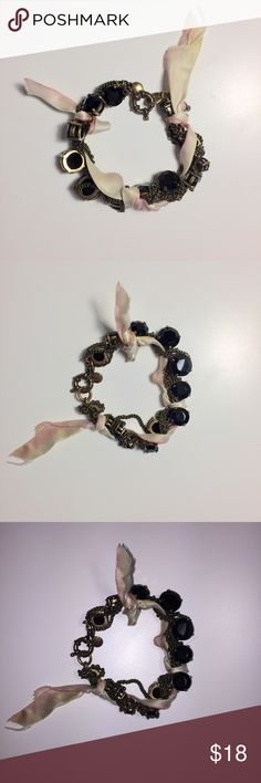 J Crew Ribbon Gem and Chain Bracelet Black gems of graduated sizes are braided between gold chains and pink and ivory ombré ribbon. J. Crew Jewelry Bracelets