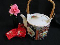 Imari porcelain teapot bamboo handle Miyako