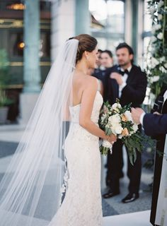 strapless lace gown and floor-length veil