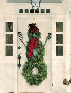 Snowman Wreath door decor I may need to add mitten to mine for this year!!