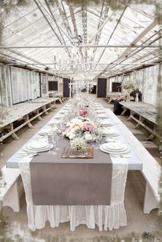 A beautiful wedding feasting table in an old abandoned greenhouse.  Design by Tricia Fountaine