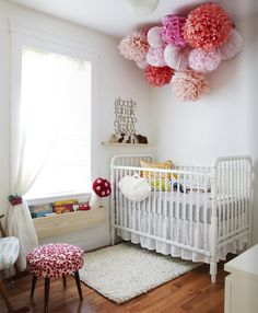I love these poms for Cam's room. Love the book rack under the window sill and the alphabet