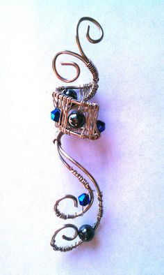 wire wrapped dread bead with black and blue beads
