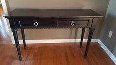 Black modern 2-drawer entry table w/ pr modern lamps.