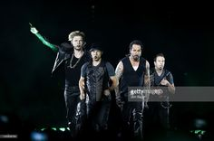 Nick Carter, Brian Littrell, A. J. McLean and Howie Dorough of the Backstreet Boys perform on stage at Echo Arena on April 23, 2012 in Liverpool, United Kingdom.