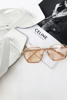 Make a statement in the retro inspired Kensington Sunglasses! They feature gold toned hexagonal frames with tinted orange lenses and chain style arms. The perfect way to take your outfit from basic to fashion-forward! Trendy Summer Outfits, Sabo Skirt, Trendy Shoes, Aesthetic Fashion, Fashion 2020, Chanel Ballet Flats, Latest Fashion Trends, Cat Eye Sunglasses, Fashion Forward
