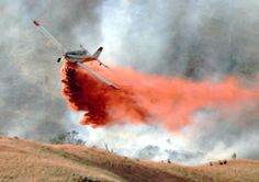 Fire retardant being dropped on a wildfire