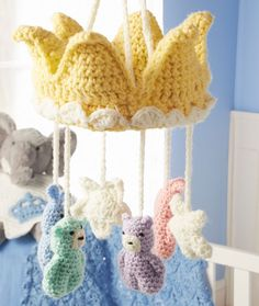 Sleep Tight Royal Mobile Crochet Pattern | Red Heart. Free patterns. I love the crown, but I would probably use different patterns for the animals.