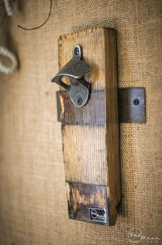 Build your own wall mounted bottle opener using a whiskey barrel stave.