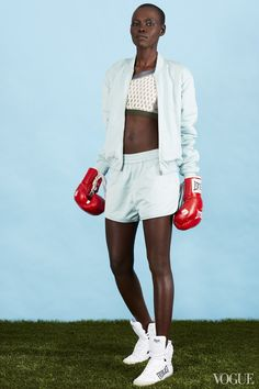 January 19 - You want to be light on your feet when going up against a heavy bag. Keep your look minimal.Grace Bol in a T by Alexander Wang jacket and bottom, VPL bra, and Everlast gloves and shoesT by Alexander Wang Technical Memory satin bomber jacket, $475alexanderwang.comT by Alexander Wang Technical Memory satin track shorts, $230alexanderwang.comVPL Convergence bra, $95 For information: shopbop.comEverlast 1910