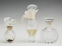 Group of Three Lalique Perfume Bottles, 20th c., for Nina Ricci, Largest- H.- 5 1/2 in., W.- 3 in., D.- 2 1/8 in.