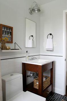 House Tweaking blog bathroom reveal.  Modern, black and white, wood vanity, open shelving, hex tile, subway tile, natural, neutral, vintage rug, black clawfoot tub shower, wood stool, modern toilet, open vanity.