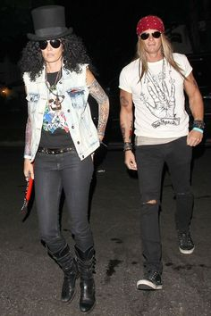 Cindy Crawford and Rande Gerber dressed up as Guns 'N' Roses members Slash and Axl Rose for the the Casamigos Halloween party