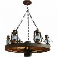 Rare Antique Wagon Wheel Chandelier - Handmade in USA. Wagon Wheel Chandeliers inspired by the old west made in America by matercraftsman Wagon Wheel Light, Wagon Wheel Chandelier, Antique Chandelier, Antique Lighting, Rustic Lighting, Lighting Ideas, Chandeliers, Western Decor, Rustic Decor