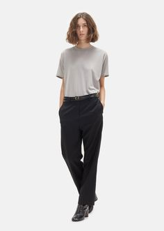 La Garçonne Exclusive Black straight-leg trousers made in a lightweight Italian tropical wool. Straight fit. Slip pockets. Back welt pockets. Zip fly with hook