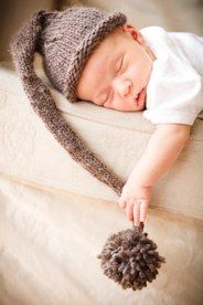 Newborn in natural light with a knitted hat that I made