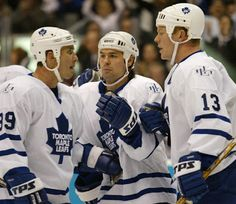 Alex Mogilny, Darcy Tucker, and Mats Sundin. I can't tell if they're celebrating or arguing. Hockey Baby, Ice Hockey, Maple Leafs Hockey, Nhl Players, Nfl Fans, Toronto Maple Leafs, Detroit Red Wings, Sports Art, The Incredibles