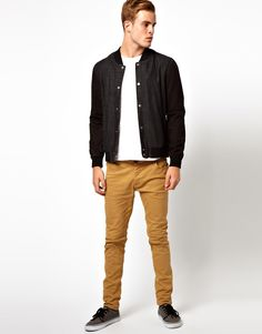Jacket with no collar and brown/tan pants