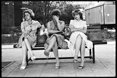 3 women sit on bench at alexander platz ddr