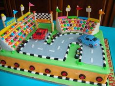 A Disney-Cars fondant cake showing Piston Cup's car racing. All the cars are in the cake are toy cars. Toddler Boy Birthday, Boy Birthday Parties, Birthday Fun, Cake Birthday, Race Track Cake, Race Car Cakes, Christmas Birthday Cake, Harry Birthday, Hot Wheels Birthday